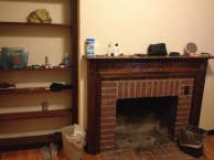 11 - I have a working fireplace and loads of shelf space.