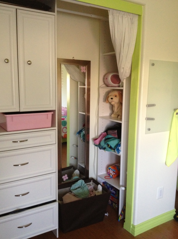 Hidden storage which houses toys now but will be invaluable to her for other things as a teen.